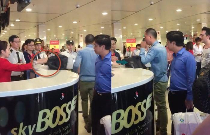 2 79131 - Clip khách đánh hụt nữ ca trưởng Vietjet Air vì 2 lần bị đẩy rơi túi xuống sàn tại sân bay Tân Sơn Nhất