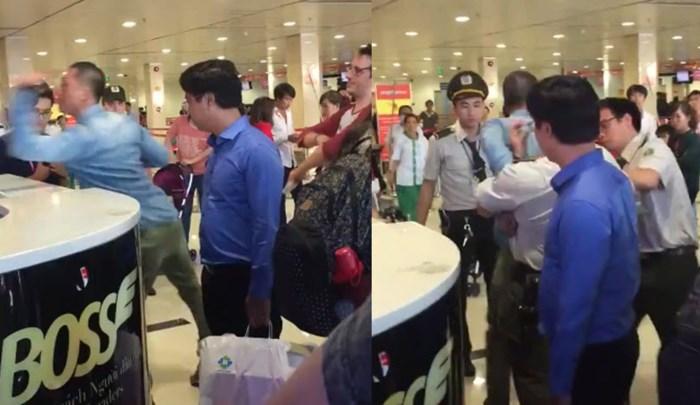 3 71706 - Clip khách đánh hụt nữ ca trưởng Vietjet Air vì 2 lần bị đẩy rơi túi xuống sàn tại sân bay Tân Sơn Nhất