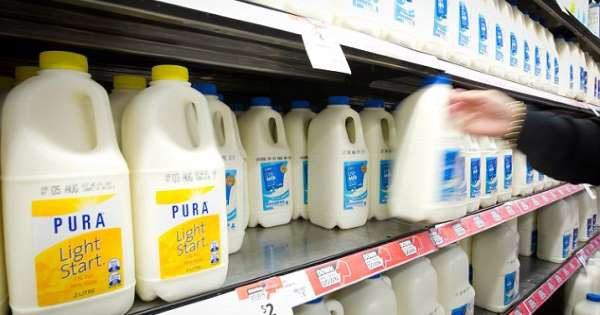 Coles, Woolworths announce milk levy