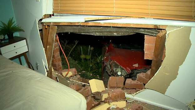 Couple's lucky escape after stolen car crashes into bedroom